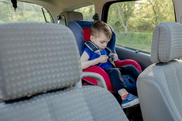 little-boy-buckled-up-with-seatbelt-inside-car-vehicle-transportation-concept-130265-5995